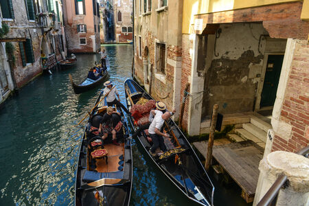 gondolier: VENICE, ITALY - OCTOBER 22: Gondolier the Grand Canal on October 22, 2014 in Venice, Italy. Gondolas are traditional Venetian rowing boats, well suited to the conditions of the Venetian lagoon