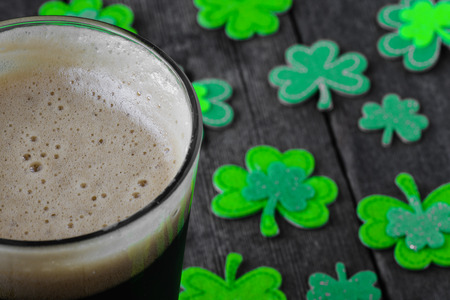 stout: Pint of Stout Beer with Green Shamrock Stock Photo