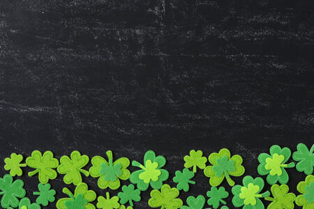 Green Clover on Chalkboard Background Background for St. Patricks Day Holiday