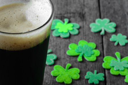 paddys: Pint of Stout Beer with Green Shamrock Stock Photo