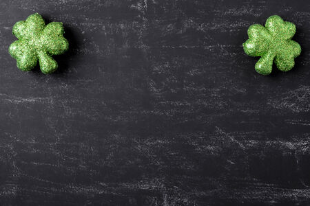 three leafed: Green Clovers on Chalkboard Background Background for St. Patricks Day Holiday