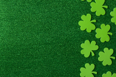 Green Clovers or Shamrocks  on Green Background Background for St. Patrick's Day Holiday Stock Photo