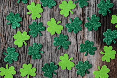 patricks: Green Clovers or Shamrocks  on Rustic Wood Background Background for St. Patricks Day Holiday