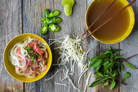 vietnamese food: Pho Vietnamese beef soup on a wooden background Stock Photo