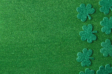 three leafed: Green Clovers or Shamrocks  on Green Background Background for St. Patricks Day Holiday