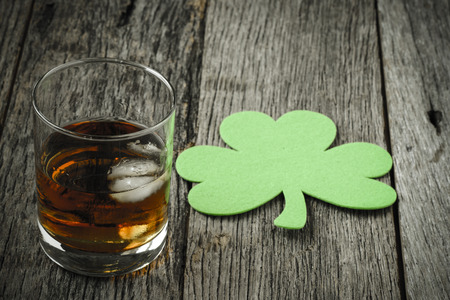 Glass of Whiskey and Clovers to celebrate St Patrick's Day