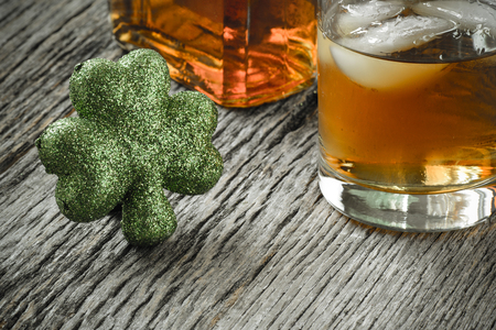 patricks day: Glass of Whiskey and Clovers to celebrate St Patricks Day