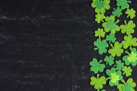 Green Clover on Chalkboard Background Background for St. Patricks Day Holiday photo