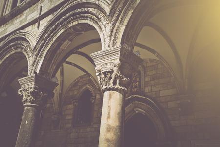 pillar: Gothic Stone Pillars in Retro Film Style Stock Photo