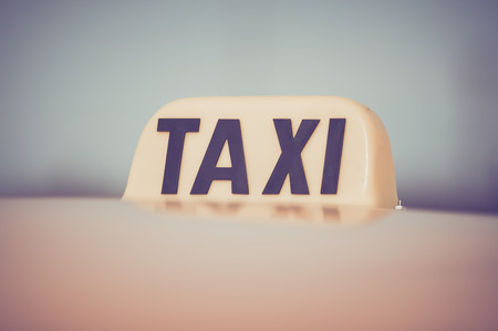 carting: Taxi Cab Car Roof Sign Close Up in Retro Film Style