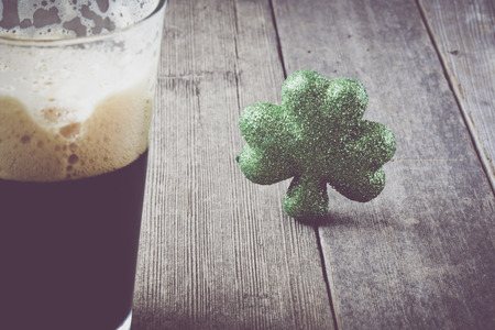 paddys: Pint of Stout Beer with Green Shamrock with Vintage Film Filter