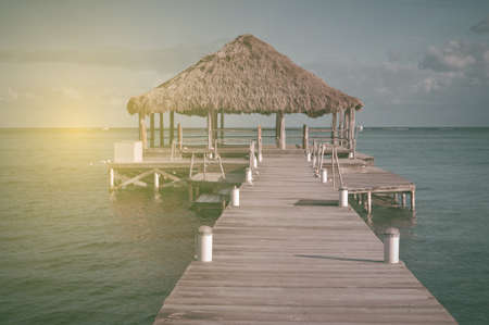 palapa: Vintage Beach Deck with Palapa floating in the water with Vintage Stock Photo