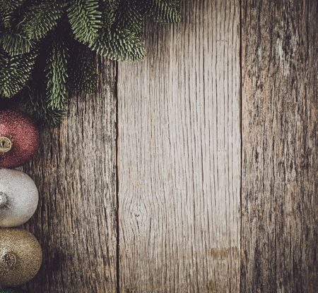 gold ornament: Christmas Pine Needle and Ornaments on a Rustic Wood Background