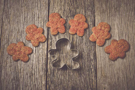pastry cutter: Gingerbread Cookie and Cutter on Wood Background