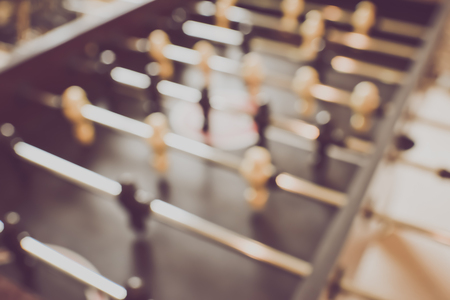 foosball: Blurred Foosball Table with vintage Stock Photo
