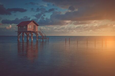 belize: Home on the Ocean in Ambergris Caye Belize with Vintage Filter Stock Photo