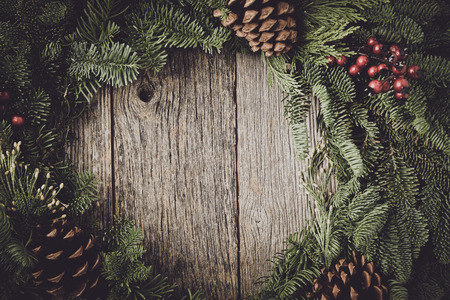 pine wreath: Christmas Wreath with Rustic Wood Background