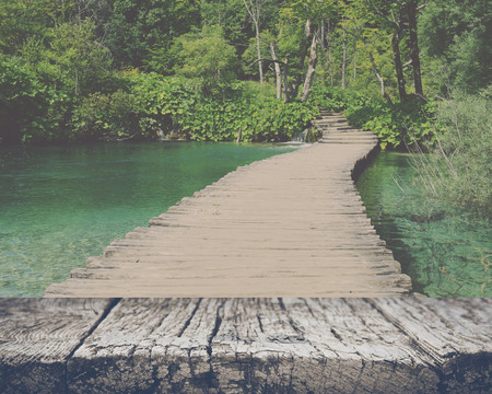 Wooden Bridge over a Pond in Plitvice National Park with retro style filter
