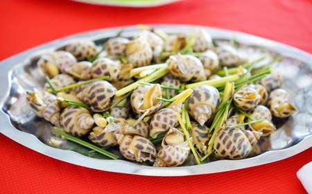 Tasty steamed sweet snail with lemongrass Reklamní fotografie