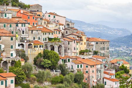 chaotically: Small houses chaotically standing on the hill in Vezzano Ligure, Italy