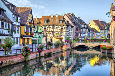 Colorful traditional french houses on the side of river Lauch in Petite Venise, Colmar, France