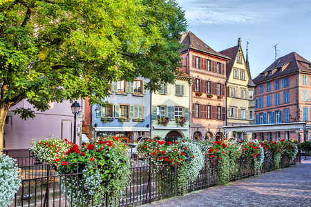 Colorful french houses with flowers on foreground in Colmar, France photo