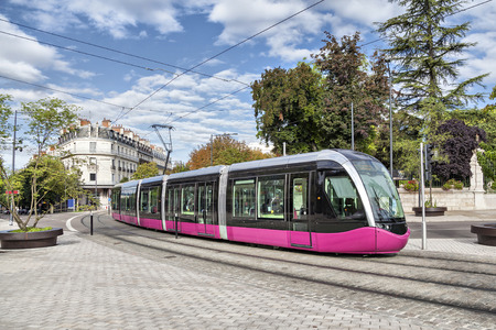 Modern tram on the street of city Dijon, France Standard-Bild