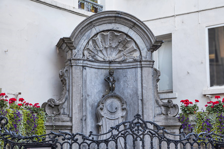 urinating: Brussels, Belgium - September 12 2014: The famous Mannekene Pis, the iconic statue of Brussels