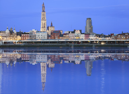 Antwerpen skyline reflecting in river Schelde in the evening