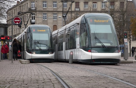trams: Strasbourg, France - November 23: Two modern trams staying on the tram stop Ancienne Synagogue - Les Halles on 23.11.2013 in Strasbourg, France.