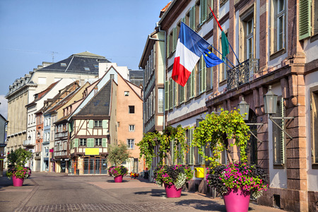 colmar: French flag on the building in Colmar, France Stock Photo