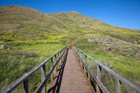 footway: Wooden bridge on the pedestrian route to the Cape Ponta de Sao Lourenco, Madeira island, Portugal
