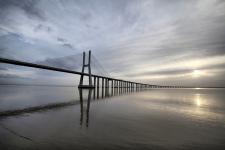 The Vasco da Gama Bridge is a famous landmark in Lisbon, Portugal photo