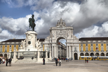 Lisbon, Portugal - February 15 2014: People walking on Praca Comercio square in Lisbon, Portugal photo
