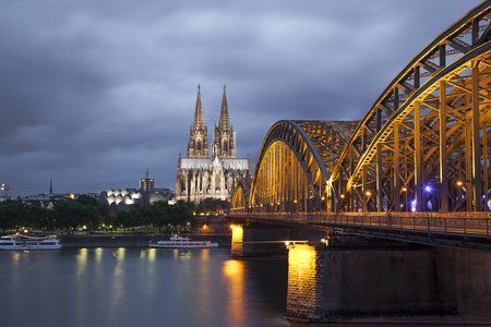 rhine westphalia: Cologne Cathedral and Hohenzollern Bridge in evening. Cologne, North Rhine - Westphalia, Germany