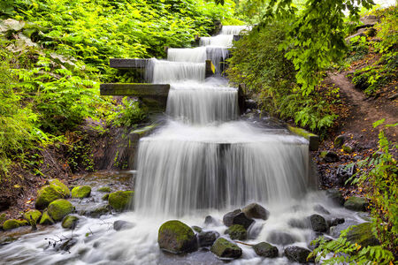 Cascade waterfall in Planten un Blomen park in Hamburg, Germany photo