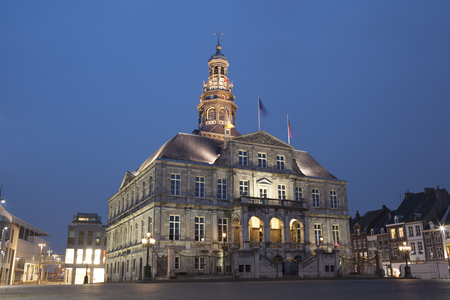 erected: Night view to town hall on the Market square of Maastricht,. The building was erected in the 17th century by Pieter Post.