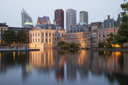 Evening view on Binnenhof Palace and high modern buildings in Hague