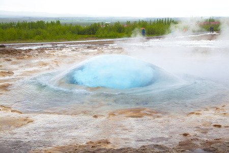 appear: Big blue bubble appear  before the eruption of the geyser Strokkur, Iceland