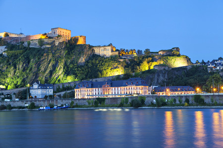castle buildings: Evening view on Fortress Ehrenbreitstein on the side of river Rhine in Koblenz, Germany Editorial