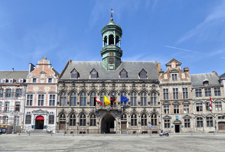 Gothic style City Hall and its renaissance bell tower on the Grand Place square in Mons, Belgium