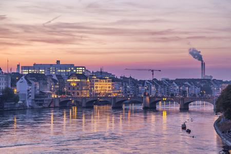 rhein: Mittlere bridge over Rhine river and city skyline at sunset, Basel, Switzerland