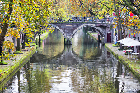 Double arc bridge across canal in the historical center of Utrecht , Netherlands Stock Photo