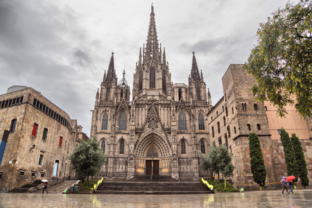 Barcelona Cathedral, located in Gothic Quarter in rainy morning Фото со стока