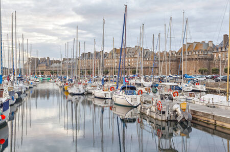 Boats and yachts in the port of historical city Saint Malo, Brittany, France Standard-Bild