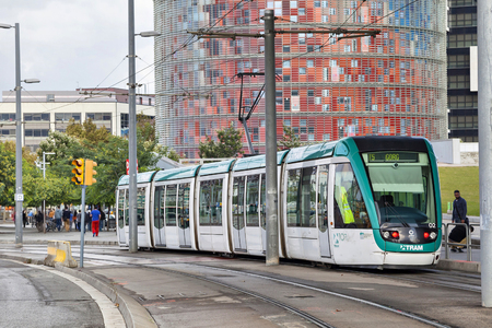 Barcelona, Spain - November 03, 2014: Barcelona tram known as Trambaix with Agbar tower on background Editorial