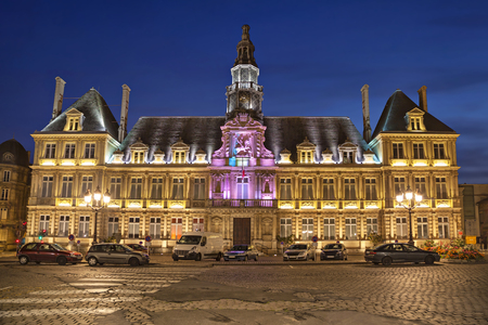 Illuminated city hall of Reims in the evening, Champagne-Ardenne, France