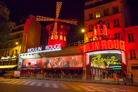 rouge: Paris, France - July 17 2014: The Moulin Rouge cabaret at night