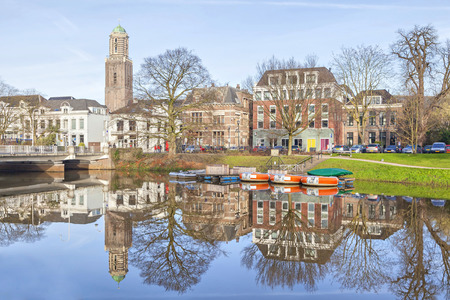 buildings on water: Zwolle skyline reflecting in canal, Netherlnds Editorial