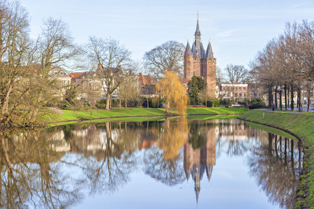 Medieval city gate Sassenpoort reflecting in water, Zwolle, Netherlands